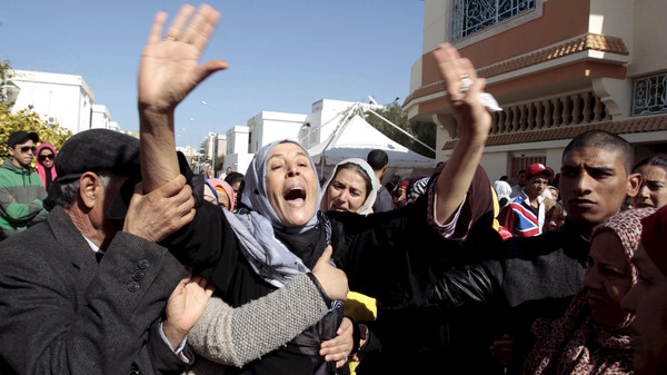 File photo of the mother of Yassine al-Abidi, who gunned down 20 foreign tourists at Tunisia's Bardo Museum, crying during her son's funeral in Tunis.