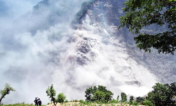 This handout photograph released by the Nepal Army on Sunday, shows an area in Nepal's mountainous northwest Myagdi district affected by a landslide.