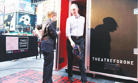 An audience member steps out of the 'Theatre for One' performance space in New York's Times Square.