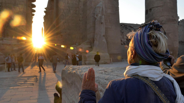 A tourist makes a sunrise visit to the temple of Karnak on the day of the winter solstice in Luxor, 510 kilometers (320 miles) south of Cairo, Egypt, Saturday, Dec. 21, 2013.