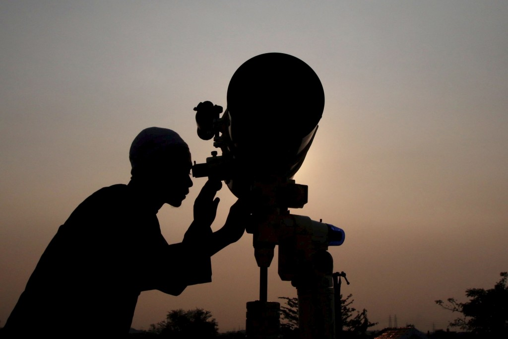 An officer looks for the position of the new moon in order to determine the first day of the holy month of Ramadan in Jakarta.