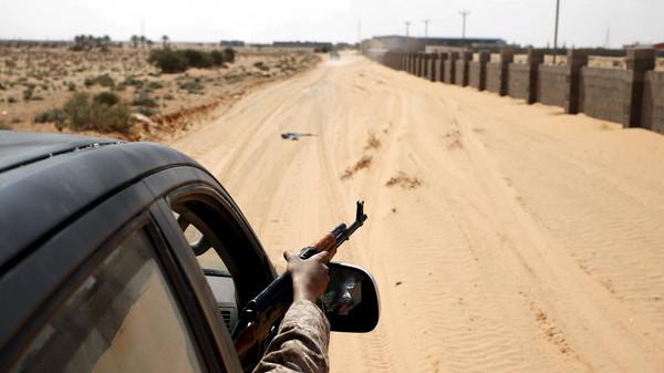 Libya Dawn fighters patrol with a vehicle near Sirte March 19, 2015.