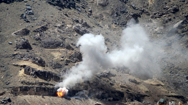 Smoke billows from Noqum mountain after it was hit by an air strike in Yemen's capital Sanaa.