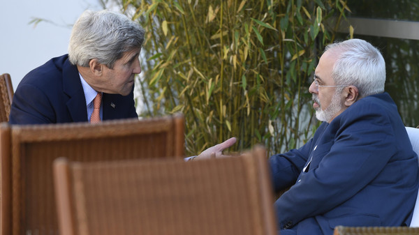 U.S. Secretary of State John Kerry, left, talks with Iranian Foreign Minister Mohammad Javad Zarif, in Geneva, Switzerland, Saturday, May 30, 2015.