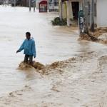 Rain deepens flood misery in the Philippines after typhoon kills 22