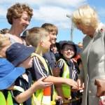Kiwi royal fan plants a cheeky kiss on Prince Charles