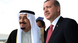Turkish President Recep Tayyip Erdogan, right, and Saudi Arabia's King Salman shake hands during a ceremony at Esenboga Airport in Ankara, Turkey, Monday, April 11, 2016