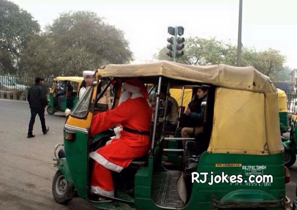 Santa in Indian Riksha devering Gifts
