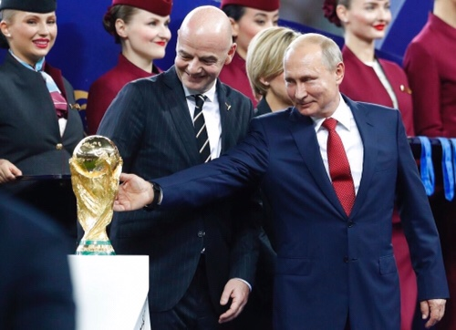Putin looks trophy like