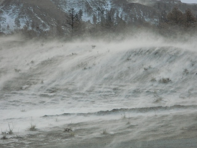 Blowing snow across the land.
