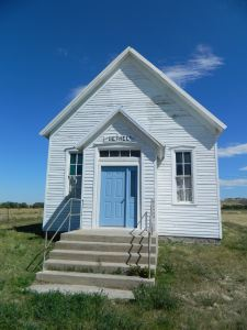 Bethel Community Church with a newly painted blue door.