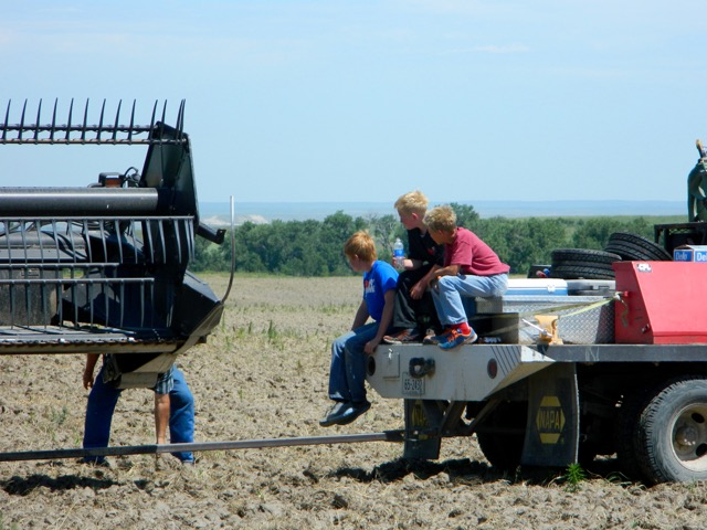 Future farmers on tailgait of service truck.
