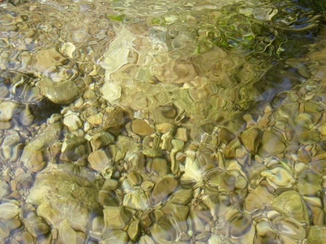 Spring flows gently over new tumbled creek rocks along East Ash Creek, Nebraska National Forest.