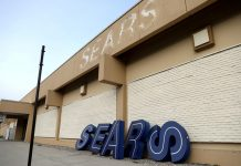 FILE PHOTO: A dismantled sign sits leaning outside a Sears department store one day after it closed as part of multiple store closures by Sears Holdings Corp in the United States in Nanuet, New York, U.S., January 7, 2019. REUTERS/Mike Segar