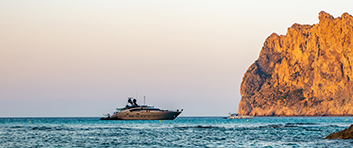 Super Yacht in a Cove at Sunset off the Balearic Islands