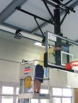 Maintenance operation on a roof mounted basketball system