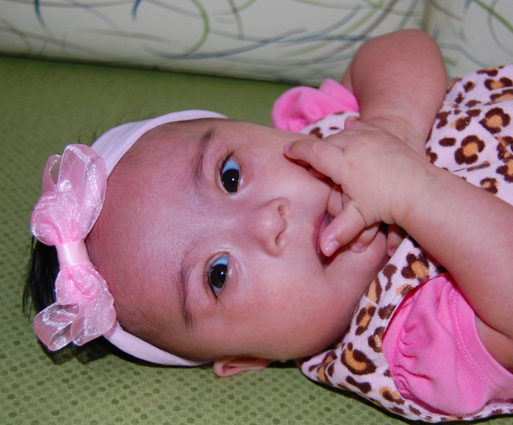 Baby Maria-Lizbeth wears an adorable bow