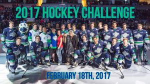 Seattle Thunderbirds surround Bretton and his family for the Hockey Challenge puck drop