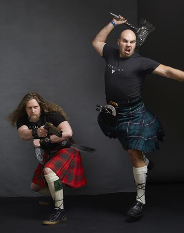 Forrest and Mark, Bungie employees, posing with weapons for Men in Kilts