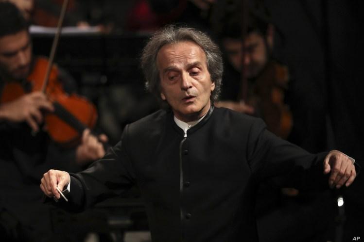 Iranian American maestro Shahrdad Rohani conducts the Tehran Symphony Orchestra at Unity Hall, in Tehran, Iran, July 3, 2019.