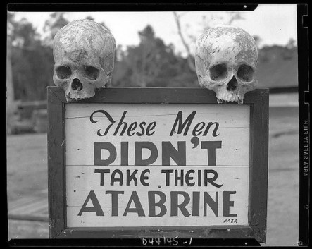 Advertisement for Atabrine, an anti-malaria drug. Sign was put up at the 363rd station hospital in Papua, New Guinea during WWII