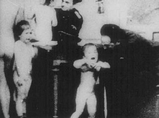 Polish children examined by German officers to see if  they qualify as Aryan, and would be allowed to live