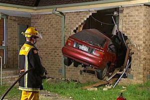 Car through house