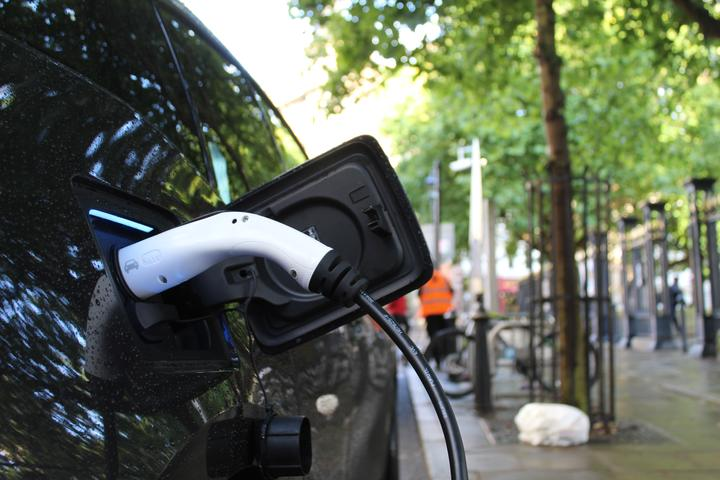 Charging an electric vehicle. EV. Electric car.