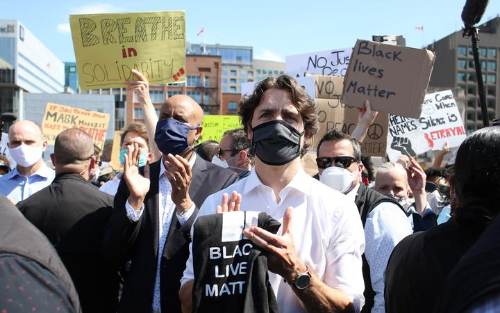 Canadian Prime Minister Justin Trudeau takes part in a Black Lives Matter protest on Parliament Hill June 5, 2020 in Ottawa, Canada.