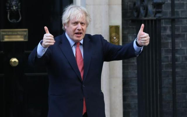 """LONDON, UNITED KINGDOM - MAY 28: British Prime Minister Boris Johnson gives thumbs up outside 10 Downing Street in London, United Kingdom on May 28, 2020, as part of the national """"clap for carers"""" to show thanks for the work of Britain's National Health Service (NHS) workers"""
