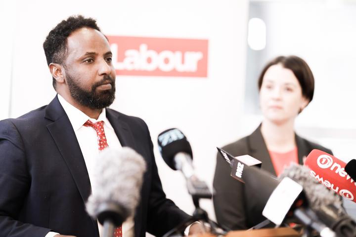 Ibrahim Omer, at podium.