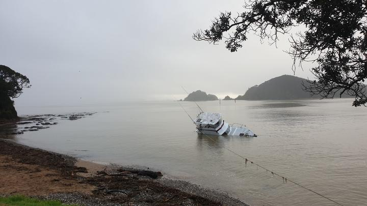 A launch which was knocked off its piles at Waitangi during the wild weather over the weekend drifted to Horotutu Beach in Paihia, where salvage teams have been trying to get it out of the water.