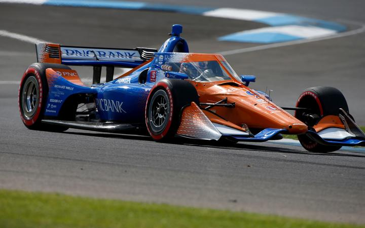 IndyCar driver Scott Dixon (9) drives through turn 2 during practice for the IndyCar Harvest GP Race 1 at the Indianapolis Motor Speedway in Indianapolis, Indiana.