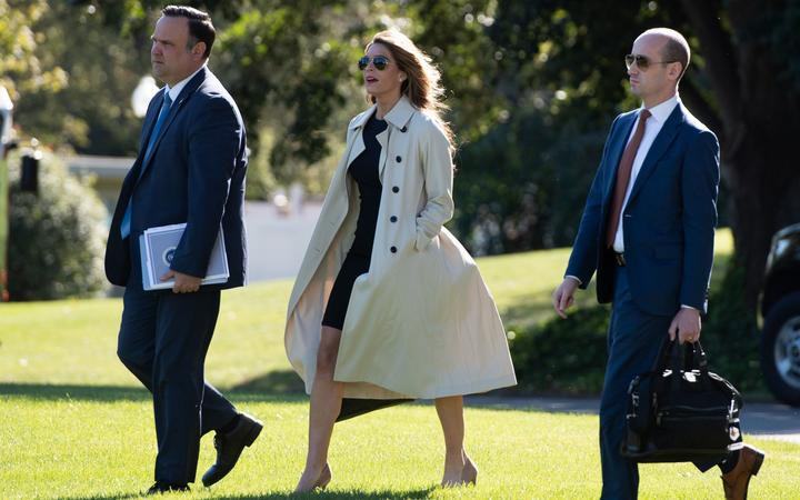 Dan Scavino (L), Director of White House Social Media, Hope Hicks, White House counselor, and Stephen Miller (R), White House senior advisor, walk to Marine One to join Trump, as he travels to Ohio.