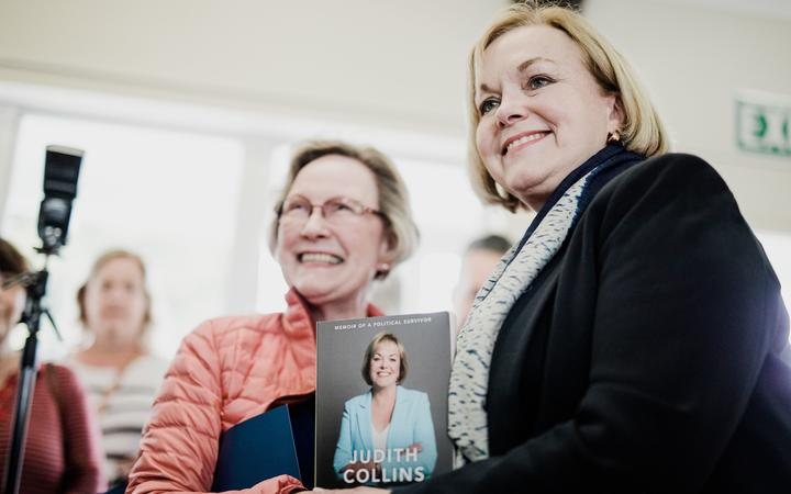 Judith Collins with her book in Wellington