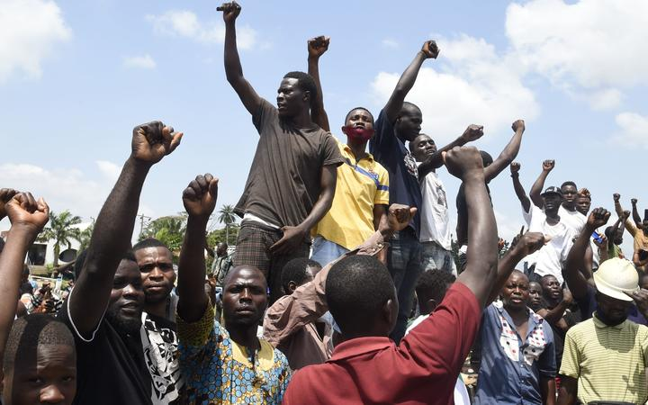 Protesters chant and sing solidarity songs as they barricade barricade the Lagos-Ibadan expressway to protest against police brutality and the killing of protesters by the military, at Magboro, Ogun State, on October 21, 2020.