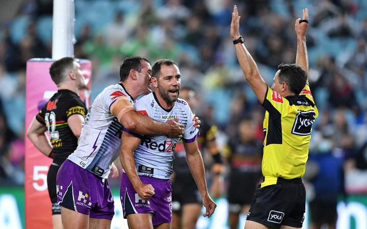 Cameron Smith celebrates scoring a try for the Melbourne Storm in the 2020 NRL grand final against the Penrith Panthers at ANZ Stadium in Sydney.