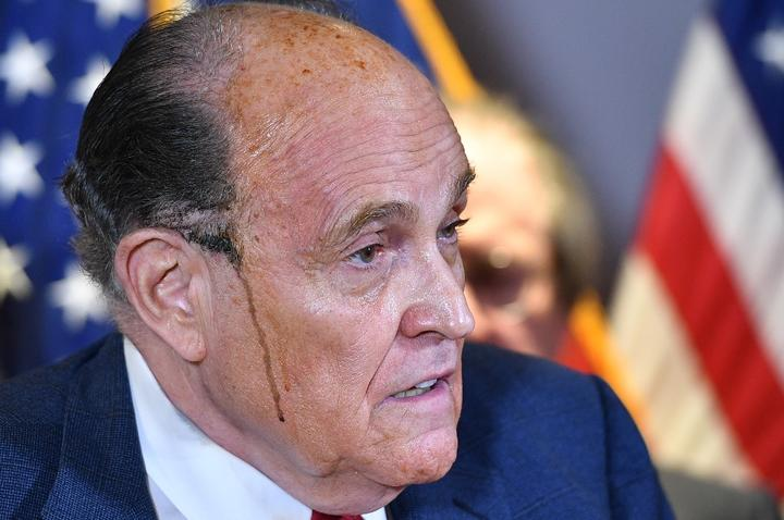 Trump's personal lawyer Rudy Giuliani perspires as he speaks during a press conference at the Republican National Committee headquarters in Washington, DC, on November 19, 2020.