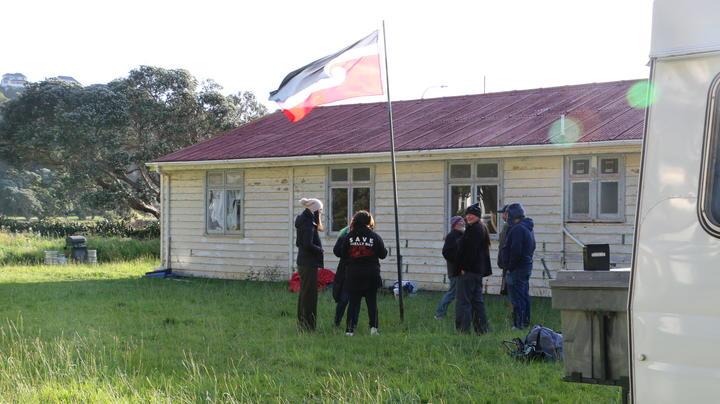 Mau Whenua supporters fly the Tino Rangatiratanga flag at an occupation of Wellington's Shelly Bay.