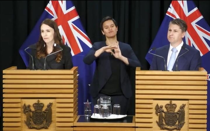 Prime Minister Jacinda Ardern and Workplace Relations and Safety Minister Michael Wood speak after a Cabinet meeting.