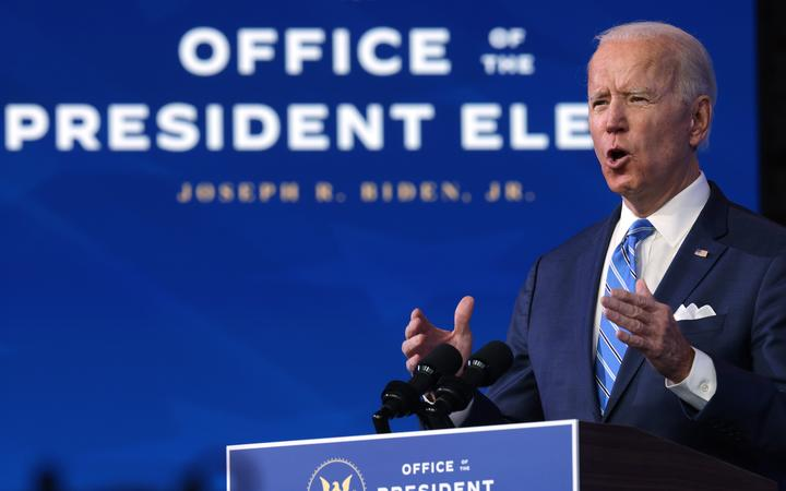 US President-elect Joe Biden lays out his plan for combating the coronavirus and jump-starting the nation's economy at the Queen theater January 14, 2021 in Wilmington, Delaware.