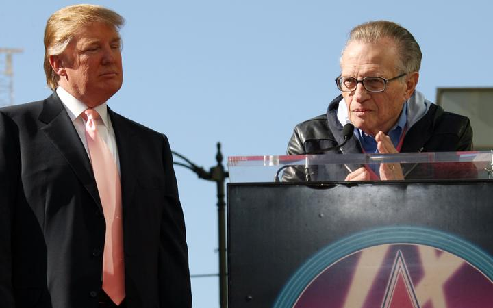 "(FILES) In this file photo taken on January 16, 2007, CNN's ""Larry King Live"" host, Larry King (R), delivers a speech as US billionire Donald Trump (L) was honored with the 2,327th star on the Hollywood Walk of Fame on Hollywood Boulevard in Hollywood."