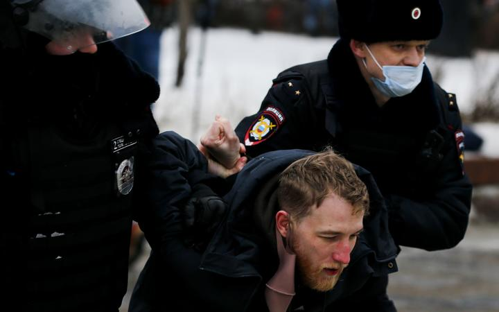 MOSCOW, RUSSIA - JANUARY 23: Police take a protester into custody during a protest demanding the release of Russian opposition leader Alexei Navalny in Moscow, Russia on January 23, 2021.