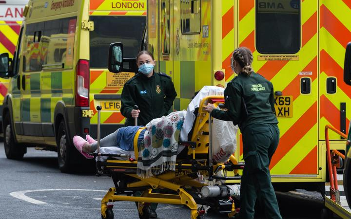Paramedics transport a patient  from the ambulance to the emergency department at the the Royal London Hospital, on 15 January, 2021 in London, England.
