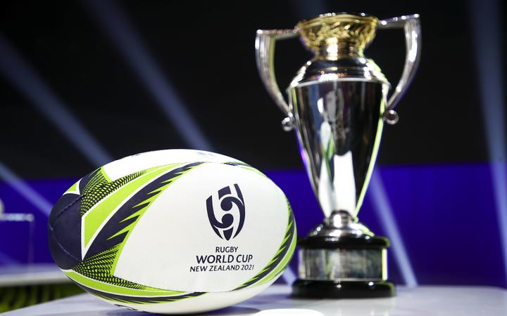 The Women's Rugby World Cup and ball on display during the Rugby World Cup 2021 Draw event.
