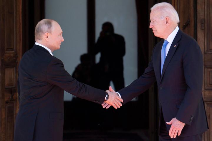 Russian President Vladimir Putin shakes hands with US President Joe Biden prior to the US-Russia summit in Geneva on 16 June 2021.
