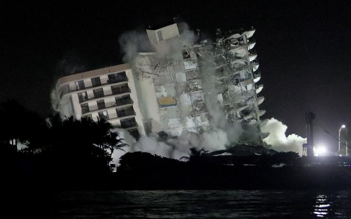 The remaining part of the partially collapsed 12-story Champlain Towers South condo building fell in a controlled demolition on July 4, 2021 in Surfside, Florida
