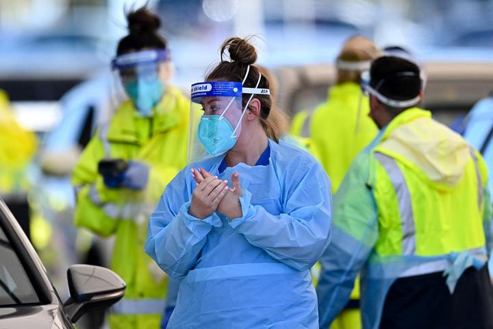 Health workers conduct Covid-19 tests at the St. Vincent's Hospital drive-through testing clinic at Bondi Beach in Sydney 27 June, 2021.