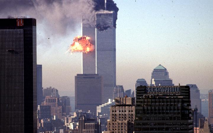 (FILES) In this file photo smoke and flames erupt from the twin towers of the World Trade Center after commercial aircraft were deliberately crashed into the buildings in lower Manhattan, New York on September 11, 2001.