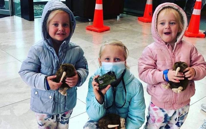 Six-year-old Liane with 2-year-old twins Maya and Karla.